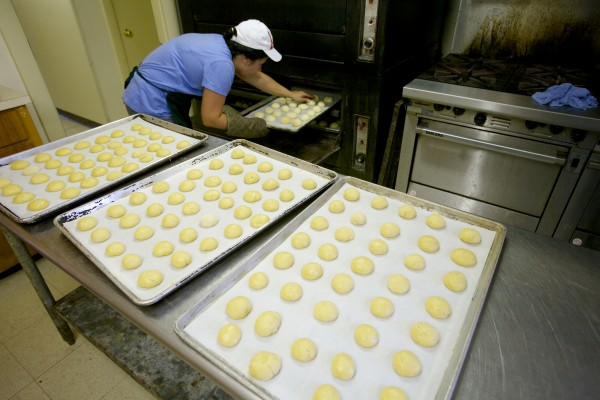 Becky Mitchell checks on a batch of cookies Wednesday at St. Peter's Church in Portland as volunteers bake in advance of this weekend's 88th annual Italian Bazaar.