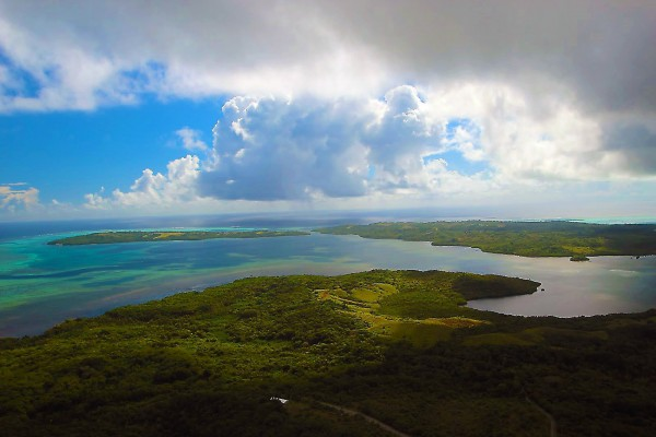 Yap consists of three main islands plus small atolls, in the Caroline Islands group in the western Pacific. The altitude of Colonia, the capital of low-lying Yap, is less than 19 feet above sea level -- and global climate change is making sea levels rise.