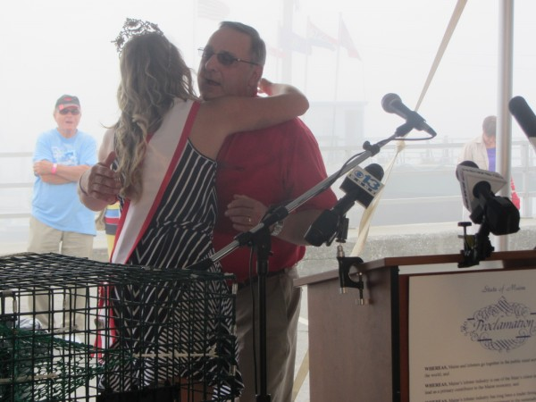 Maine Gov. Paul LePage is greeted Thursday at the Maine Lobster Festival in Rockland by Sea Goddess Melissa Philbrook.