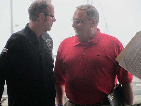 Maine Gov. Paul LePage talks with Kerry Altiero, who is owner and operator of Cafe Miranda, in Rockland on Thursday.