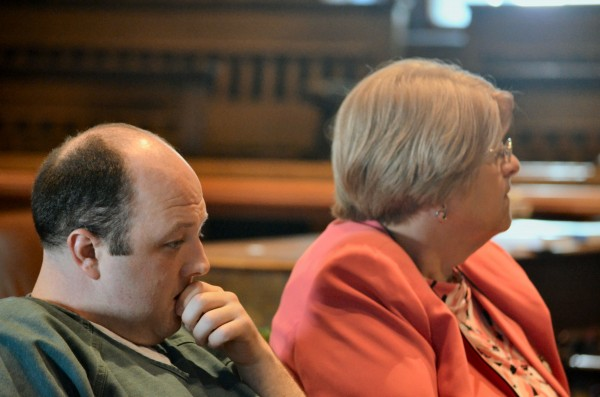 Matthew Partridge sits silently next to his attorney Pamela Ames as family members and friends of Justin Smith speak to Justice Michaela Murphy before Partridge's sentencing in Kennebec County Superior Court in Augusta. Partridge will serve 15 years in prison after pleading guilty to manslaughter.