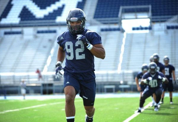 UMaine linebacker Trevor Bates runs through drills with his teammates on Morse Field during the first practice of the season Monday.