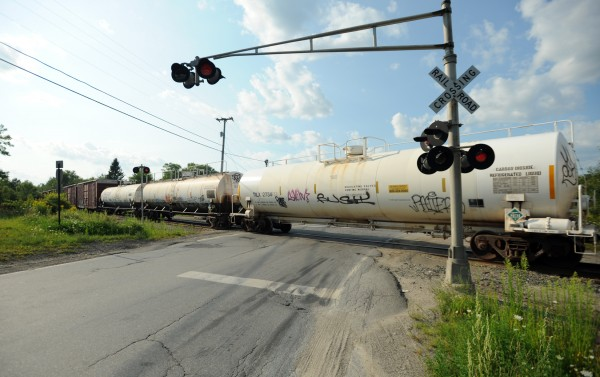 Coldbrook Road in Hermon is blocked by a tanker car as Pan Am Railways officials tend to a derailment along a nearby section of track.