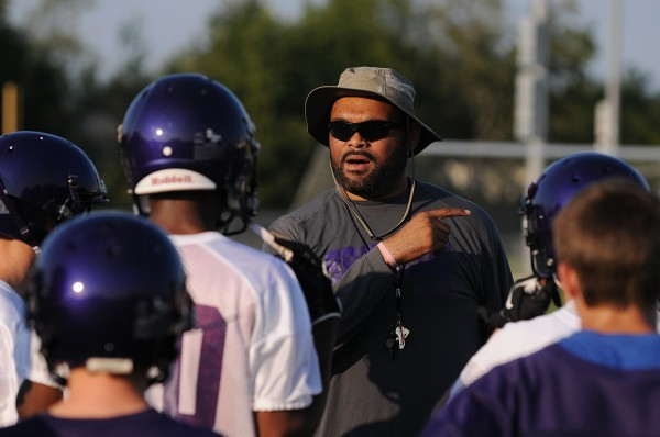 Hampden Academy head football coach Kevin Canty works with Isaiah Bess and other students during Hampden Academy's first football practice of the season at Hampden Academy on Monday.