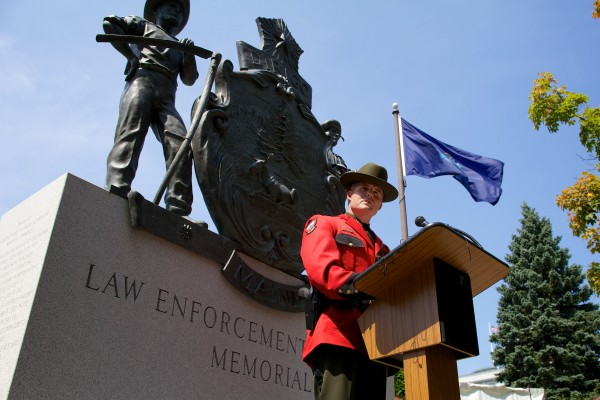 Col. Joel T. Wilkinson of the Maine Warden Service speaks in front of the Maine Law Enforcement Memorial in Augusta Monday as Harry Herington rode through town on a 50-state ride to raise awareness of the dangers of being in law enforcement and to raise money for fallen officers' families.
