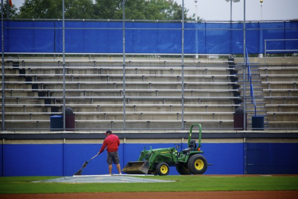 A member of the grounds crew gets the field at Mansfield Stadium ready for the Senior League World Series Thursday afternoon at Mansfield Stadium in Bangor. The tourney begins Sunday.
