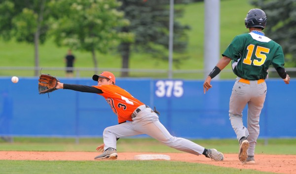 Europe-Africa's Manuel Piazza (left) makes the catch as Latin America's Luis F. Alonso runs to second base during a Senior League World Series game in Bangor on Tuesday. Alonso was safe on the play.