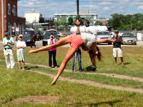 Lindsay Culbert-Olds, a member of New Hampshire-based FAQ Circus, performs an aerial straps act in front of the Circus Conservatory of America's future home on Thompson's Point in Portland.