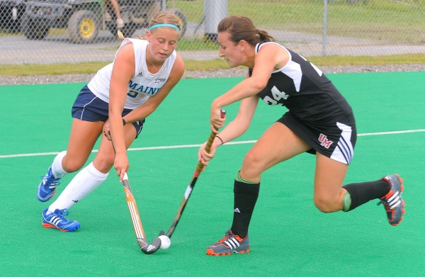 The University of Maine's Nicole Sevey (left) and University of Massachusetts' Mel Sutherland battle for the ball during the second half of the game in Orono on Friday afternoon.