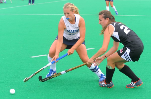 The University of Maine's Annabelle Hamilton (left) and University of Massachusetts' Mel Sutherland battle for the ball during the second half of the game in Orono on Friday afternoon.
