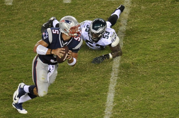 New England Patriots quarterback Tim Tebow (5) gets away from Philadelphia Eagles linebacker Emmanuel Acho (53) during the second half of a preseason game Friday night at Lincoln Financial Field in Philadelphia. The Patriots won 31-22.