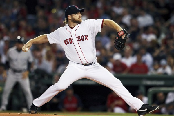 Boston's Ryan Dempster delivers a pitch against the New York Yankees Sunday night at Fenway Park in Boston. Dempster was suspended for five games Tuesday for throwing at New York's Alex Rodriguez during the game.