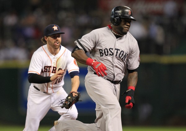 Houston Astros second baseman Jake Elmore (10) tags out Boston Red Sox designated hitter David Ortiz (34) in a rundown during the third inning of Thursday night's game at Minute Maid Park. The Red Sox won 7-5.
