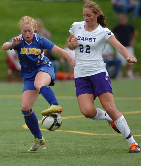 John Bapst's Abby Pyne (right) and Hermon's Jessica Allen battle for a ball during a game in September 2011. Pyne is undergoing knee surgery but will still attend Duke University and hopes to resume her soccer career for the 2015-16 season.
