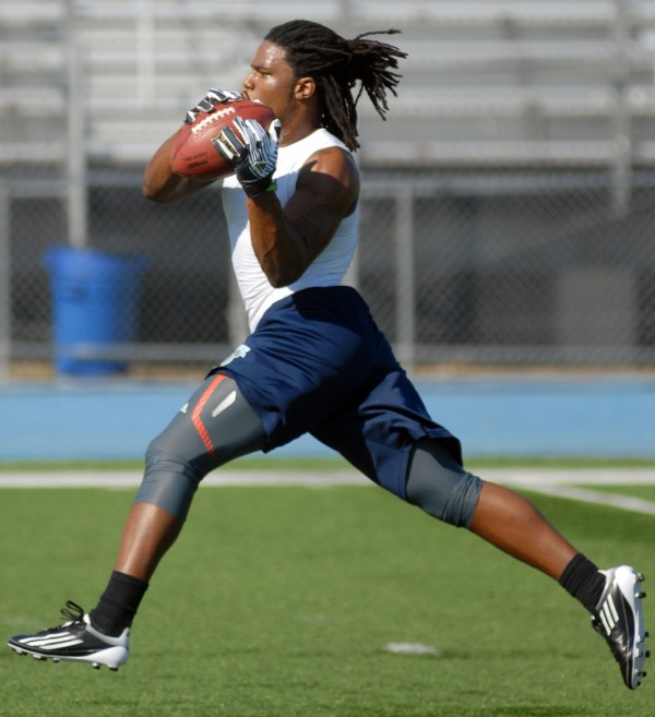 """The University of Maine's Trevor Coston runs skill drills in front of scouts from the NFL, CFL and Arena Leagues during Thursday's """"Pro Day"""" at Morse Field in Orono in March 2012. Coston signed with the Lions Wednesday."""
