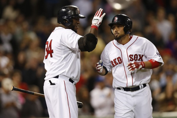Boston Red Sox designated hitter David Ortiz (34) congratulates right fielder Shane Victorino (18) after he hit a solo home run off Baltimore Orioles pitcher Chris Tillman during the sixth inning of Friday night's game at Fenway Park. The Red Sox won 4-3.