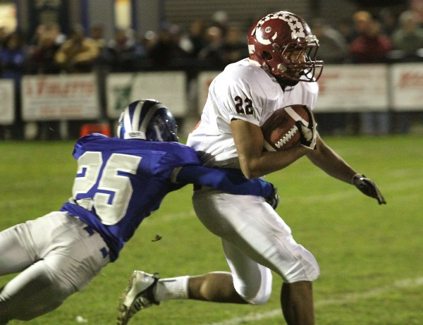 Bangor High School's Xavier Lewis fights for yardage on the opening kickoff as Lawrence High School's Jake Doolan dives for a tackle during the first half of the Pine Tree Conference Class A championship at Keyes Field in Fairfield in this 2011 file photo.