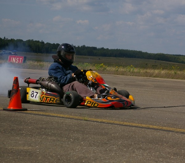 Jake Daniele of Pownal races his Intrepid six-speed shifter kart powered by a 125cc motorcycle engine to the fastest time at the Cumberland Motor Club's fourth annual autocross at Loring Commerce Center Saturday.