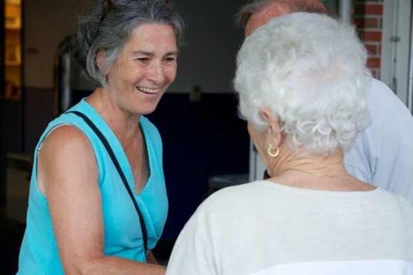 Eloise Vitelli, candidate for Maine District 19, shakes hands at the polls in Bath on Tuesday evening.