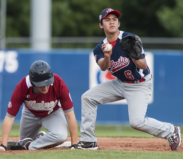 Team Asia-Pacific second baseman Phonso Balagtas (6) has the ball for the out at second after tagging Maine District 3's Ben Crichton (3) in a run-down in the second inning of their Senior League World Series game at Mansfield Stadium in Bangor, Maine Monday, August 12, 2013.