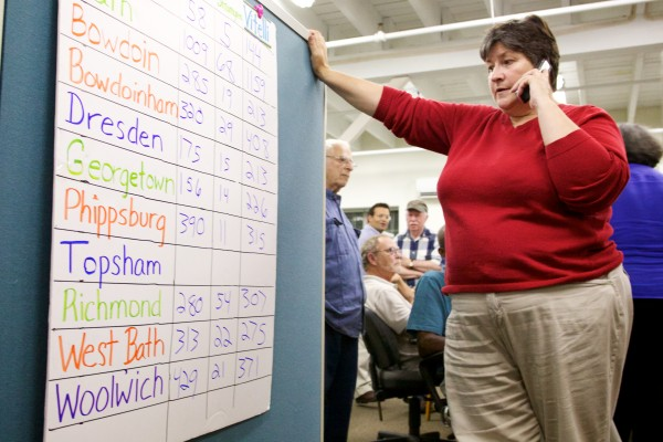 Gretta Wark, treasurer of the Sagadahoc County Democrats, gets results for Topsham Tuesday night in Bath.