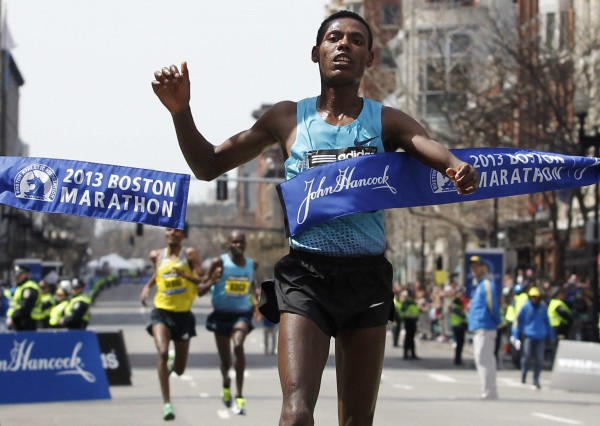 Lelisa Desisa of Ethiopia crosses the finish line to win the men's division of the 117th Boston Marathon last April. Race organizers will welcome 9,000 more runners for the 2014 race in the wake of the deadly bombings that marred this year's event.