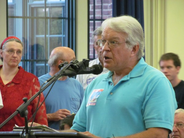 South Portland resident Robert Foster urges support of a proposed ordinance that intends to prohibit the movement of bituminous oil through the city's port during a City Council meeting Monday night.