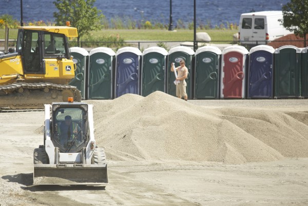 Construction crews make improvements to the concert grounds at Darling's Waterfront Pavilion on Thursday afternoon in Bangor after complaints of a foul smell coming from the organic loam underneath the grass.