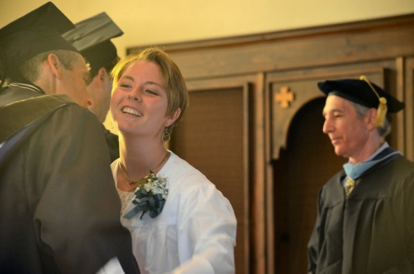 Emily Baker of Augusta embraces Glenn Cummings, Good Will-Hinckley's president and executive director, during the Maine Academy of Natural Sciences graduation on Friday.