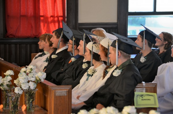 Graduating seniors from the Maine Academy of Natural Sciences watch a slide show during a graduation ceremony at Moody Chapel at Good Will-Hinckley on Friday.