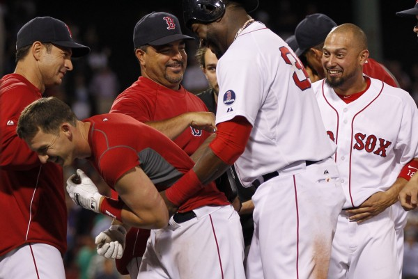 Boston's Stephen Drew (left) is congratulated by David Ortiz (34) after driving in the winning run to defeat the Seattle Mariners 5-4 in 15 innings at 12:20 a.m. Thursday at Fenway Park in Boston..