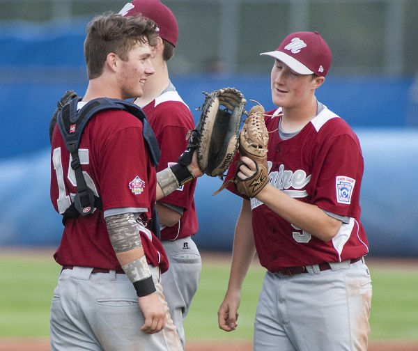 Maine District 3 catcher Sam Huston (15) encourages relief pitcher Andrew Hillier (5) at the start of Asia-Pacific's last at-bat in their Senior League World Series game at Mansfield Stadium in Bangor, Maine, Monday, August 12, 2013.