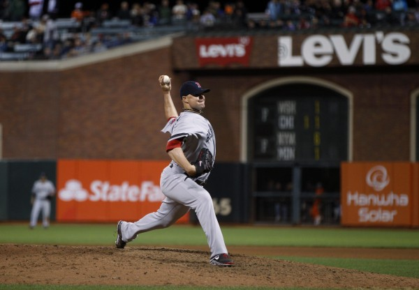 Boston's Jon Lester throws a pitch against the San Francisco Giants during the ninth inning in San Francisco Monday night.