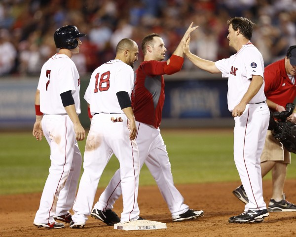 Boston Red Sox relief pitcher Steven Wright (right) congratulates Daniel Nava (29) on his game-winning hit against the Seattle Mariners in the ninth inning Thursday night at Fenway Park.