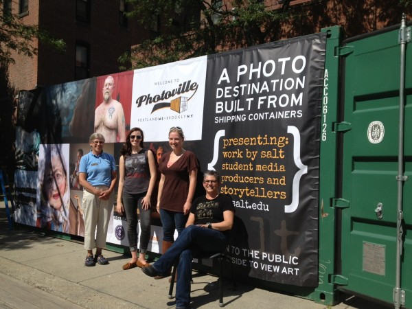 Judy Montgomery (from left), a Portland downtown guide; Caitlin Allen, a staff member at the Salt Institute; Sara Rosario of Pulp and Wire; and Donna Galluzzo, executive director of Salt Institute, show off a pop-up gallery in a shipping container in Congress Square on Friday.
