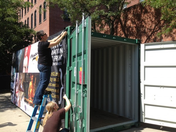The Salt Institute installs a pop-up gallery in a shipping contain in Portland's Congress Square on Friday.