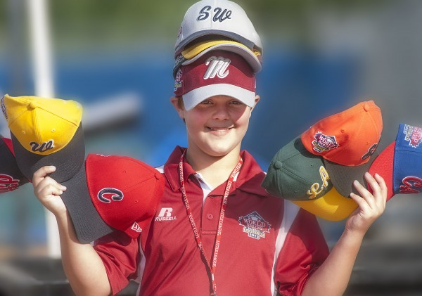 Drew Lally of Glenburn shows off his team hats from around the globe during the Senior League World Series at Mansfield Stadium in Bangor, Maine, Monday August 12, 2013.