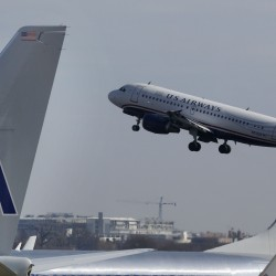 American, US Airways chiefs defend merger called bad for fliers
