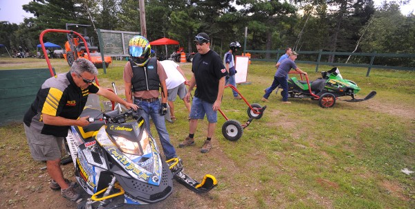 Teams get their sleds ready for test and tune on Friday at the East Branch Sno-Rovers snowmobile club in Medway. Club president Brian Wiley said he is hoping that about 70 teams with 100 sleds will participate in the club's second annual August grass drag races over the weekend.