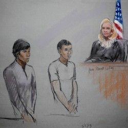 Agent: Friend of accused Boston bomber watched bag hauled away