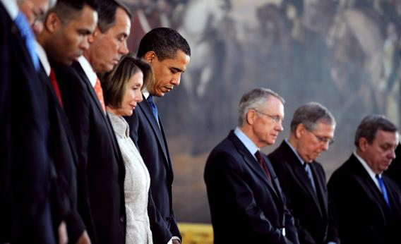 President Barack Obama bows his head for the invocation for a ceremony honoring the 200th birthday of Abraham Lincoln, Feb. 12, 2009. The Justice Department just sided with the town of Greece, N.Y., in their legislative prayer case.