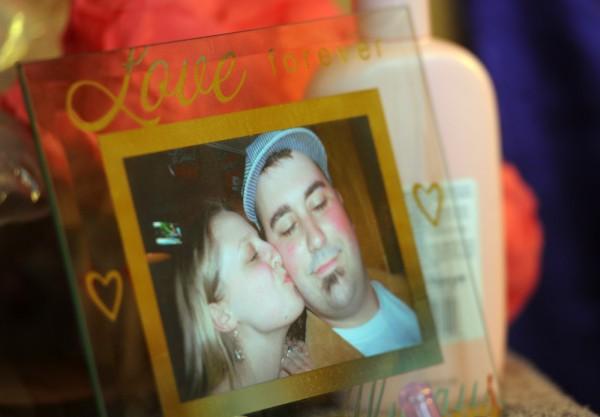 A photo of Matt and Heather Nichols sits near their daughter Ruby's crib.