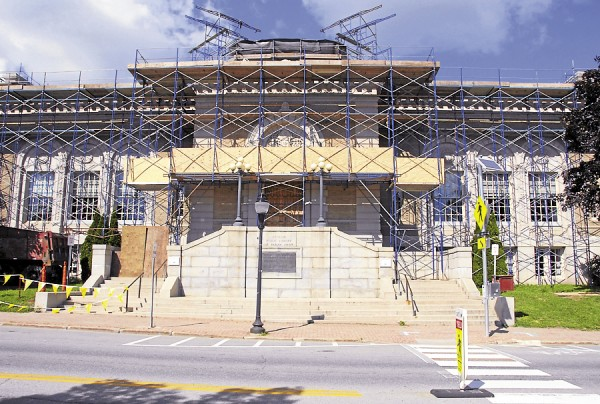 Construction scaffolding encases the Bangor Public Library as work proceeds on a new copper roof and other updates to the venerable institution.