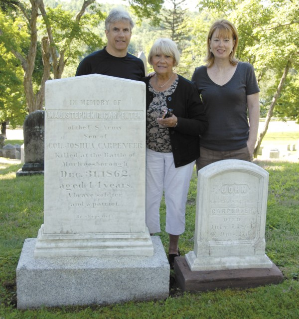 Gathered at the Mount Hope Cemetery graves of Army Maj. Stephen Decatur Carpenter and his son, John, are Elizabeth Bamford Keepper (center) of Illinois and her brother Bill Bamford and his wife, Barbara, who live in Scarborough. Carpenter, who was killed in action in Tennessee on Dec. 31, 1862, was the great-great-great uncle of Elizabeth Keepper and Bill Bamford.