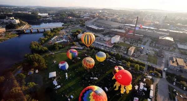 Hot air balloons launch from Simard-Payne Memorial Park Friday morning.