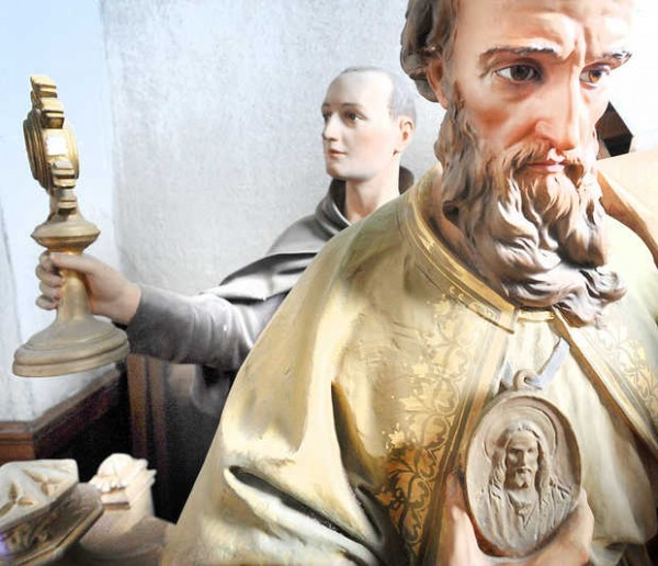 Two statues are stored in a closet at St. Louis Church in Auburn.
