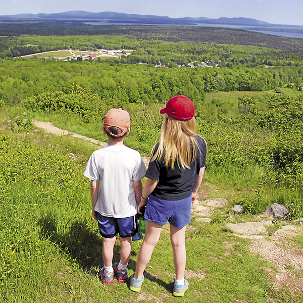 While climbing Blue Hill via the South Face Trail, Brian Swartz's oldest grandchildren look south across the Blue Hill Fairgrounds to the distant Mount Desert Island peaks. Summertime is a great time to introduce the latest generation to the natural wonders of Maine.