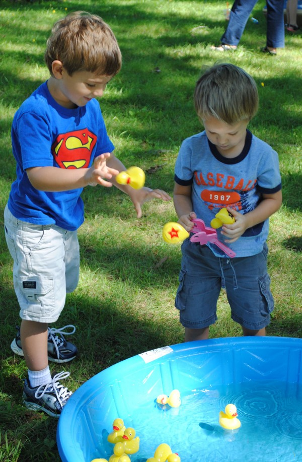 "These children of Sebasticook Valley Hospital employees were playing the ""Duck Match"" game near the finish line at Manson Park before the duck race began. There were a variety of duck-related games for kids at the event, and every participating child won a prize."