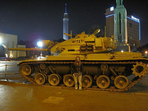 Bangor, Maine native and former John Bapst student Ellen Umphrey stands next to a military tank on the Island of Zamalek,  across the bridge from downtown Cairo in 2011. Umphrey recently left Cairo because of the unrest in Egypt.