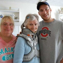 Grace Judd, 72, center, now of Canton, is flanked by her daughter Sue Cloutier and grandson James Cloutier Jr., both of Dixfield. Judd is working hard to regain some normalcy in her life after being struck by a car while collecting bottles in a ditch off Route 17 in Livermore Falls in May.